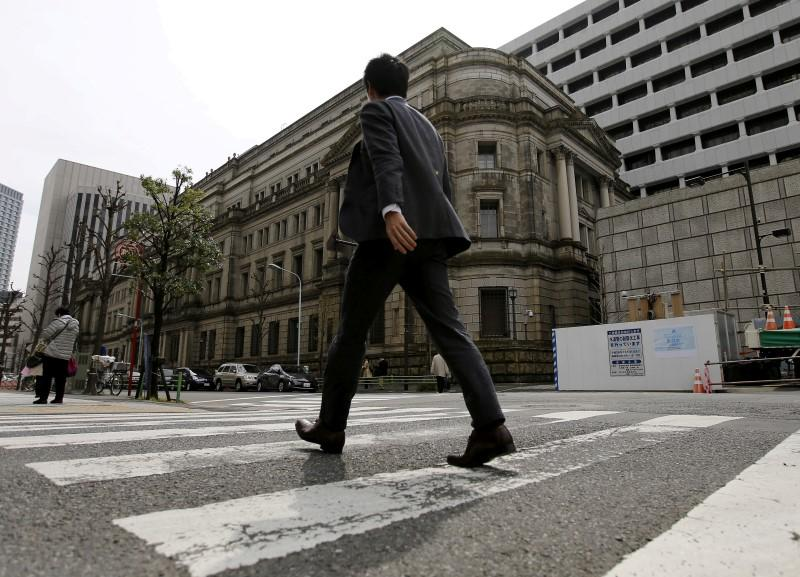 Businessman walks past the Bank of Japan (BOJ) building in Tokyo