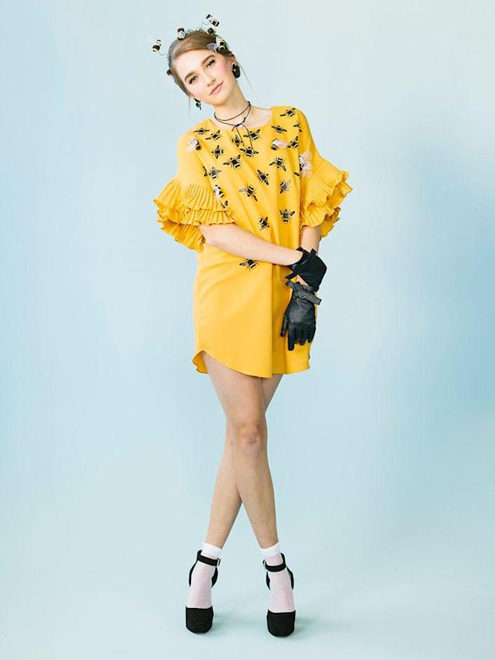 """<p>Everyone will be buzzing about your '60s-inspired costume at the Halloween party. From your beehive hairdo to your platform Mary Janes, you'll already look every inch the queen bee—but it can't hurt to add a crown for emphasis.</p><p><strong>See more at <a href=""""https://thehousethatlarsbuilt.com/2017/10/4-easy-iron-costumes.html/"""" rel=""""nofollow noopener"""" target=""""_blank"""" data-ylk=""""slk:The House That Lars Built"""" class=""""link rapid-noclick-resp"""">The House That Lars Built</a>.</strong></p><p><a class=""""link rapid-noclick-resp"""" href=""""https://www.amazon.com/Jolees-Boutique-Dimensional-Stickers-Bees/dp/B004UR8628/ref=sxin_12_ac_d_rm?tag=syn-yahoo-20&ascsubtag=%5Bartid%7C2164.g.37115224%5Bsrc%7Cyahoo-us"""" rel=""""nofollow noopener"""" target=""""_blank"""" data-ylk=""""slk:SHOP BEE STICKERS"""">SHOP BEE STICKERS</a></p>"""