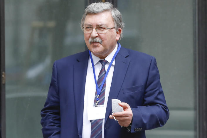 Russia's Governor to the International Atomic Energy Agency, IAEA, Mikhail Ulyanov smokes a cigarette in front of the 'Grand Hotel Wien' where closed-door nuclear talks with Iran take place in Vienna, Austria, Tuesday, April 20, 2021. (AP Photo/Lisa Leutner)
