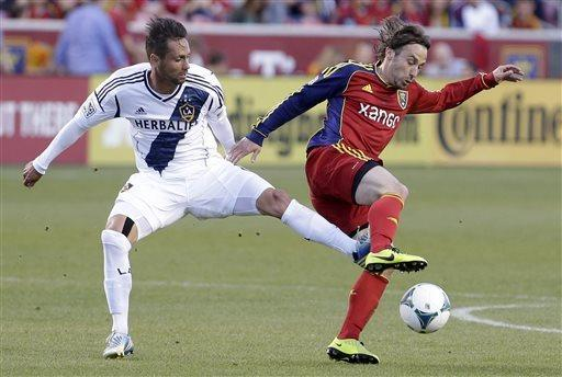 Los Angeles Galaxy midfielder Marcelo Sarvas (8) defends against Real Salt Lake midfielder Ned Grabavoy (20) during the first half of an MLS soccer game Saturday, April 27, 2013, Sandy, Utah. (AP Photo/Rick Bowmer)