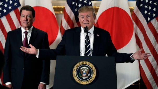PHOTO: President Donald Trump speaks with Japanese business leaders, Saturday, May 25, 2019, in Tokyo, as U.S. Ambassador to Japan William Hagerty listens. (AP Photo/Evan Vucci)