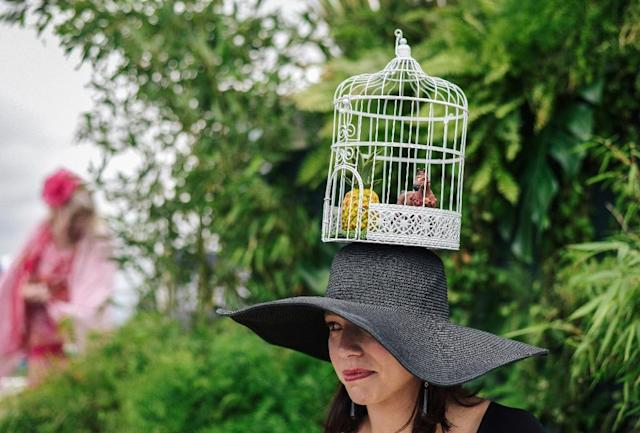 Some of the hats at the Prix de Diane took inspiration from the race itself, albeit obliquely -- such as this creation featuring a horse and a pineapple inside a bird cage (AFP Photo/LUCAS BARIOULET)