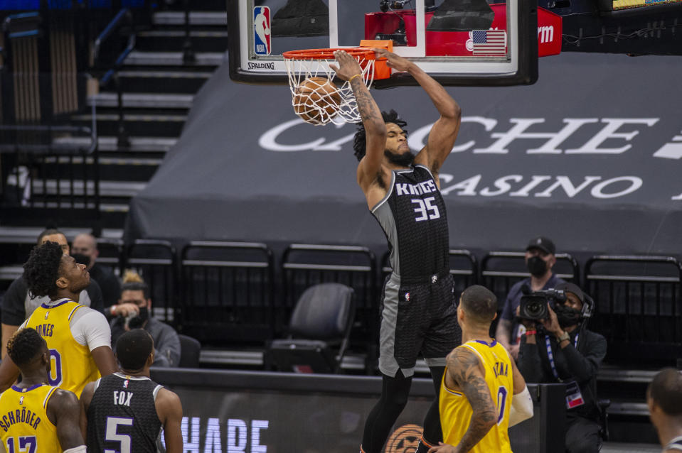 Sacramento Kings forward Marvin Bagley III (35) reverse dunks the ball against the Los Angeles Lakers during the second quarter of an NBA basketball game in Sacramento, Calif., Wednesday March 3, 2021. (AP Photo/Hector Amezcua)