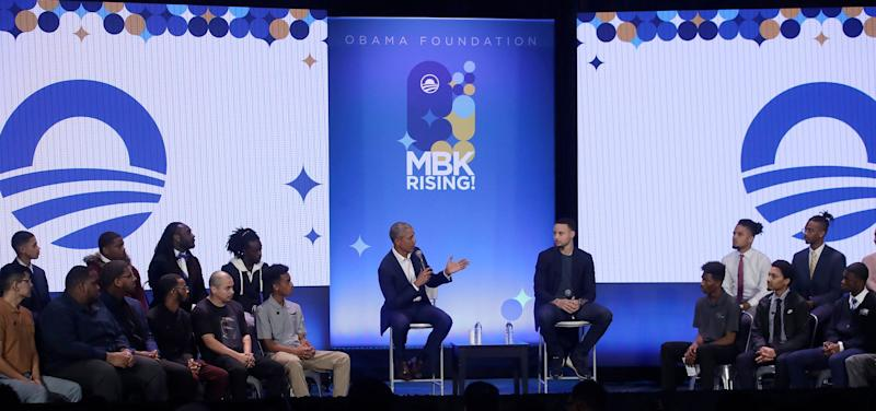 Former President Barack Obama and NBA star Steph Curry speak at a My Brother's Keeper event in Oakland, California, on Tuesday. (Photo: Jeff Chiu/ASSOCIATED PRESS)