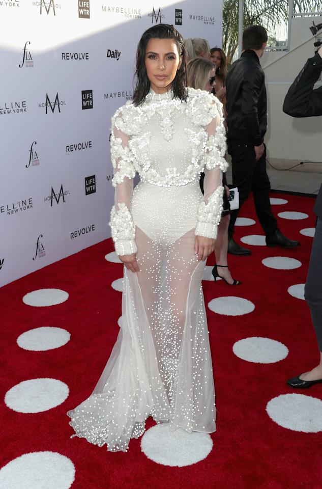 <p>Kim went for a white Givenchy gown at Daily Front Row's Fashion LA Awards.<br /><i>[Photo: Getty]</i> </p>