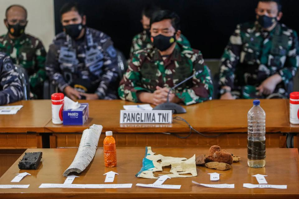 Indonesian authorities displaying debris found in the search for missing submarine KRI Nanggala-402.