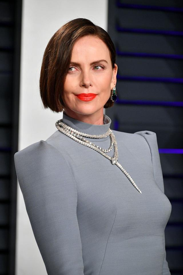 <p>Charlize Theron wore her hair in a short, layered bob to show off her new, darker dye job. Worn with a side part, it really opens up the face.</p>
