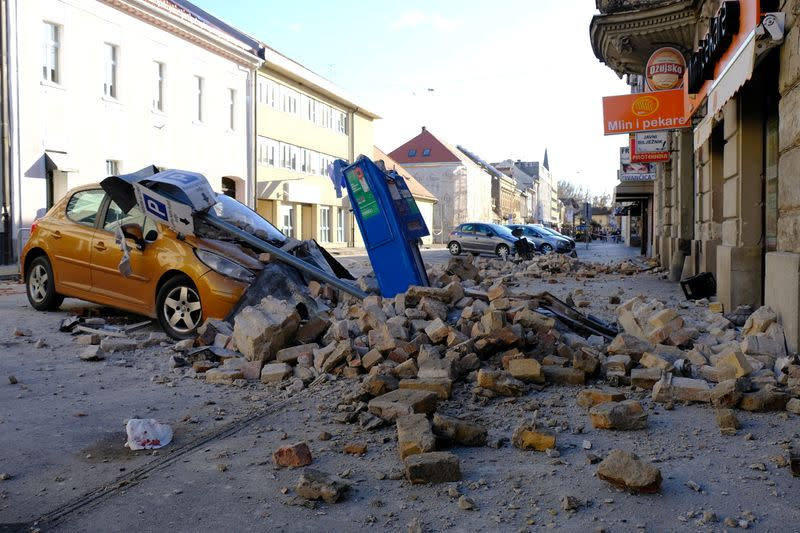 A destroyed car is seen on a street after an earthquake in Sisak