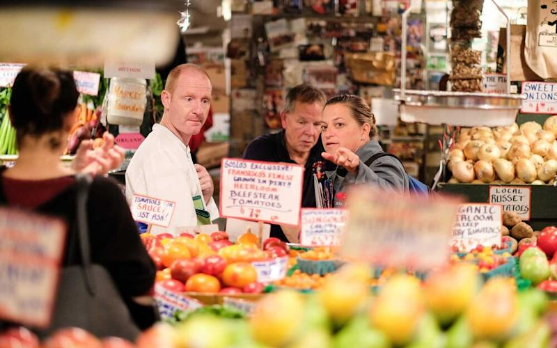 Chef Duskie Estes, right, shops at Seattle's Pike Place Market. | Courtesy of Windstar