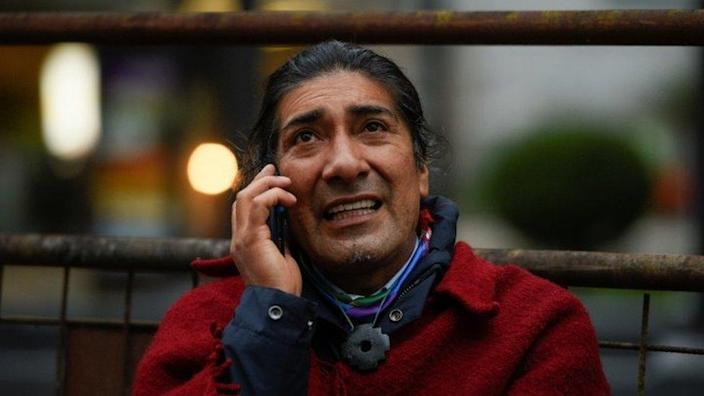Yaku Perez speaks on a mobile phone outside a hotel, in Quito, Ecuador February 8, 2021.