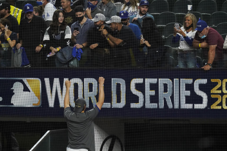 Los Angeles Dodgers shortstop Corey Seager poses for a fan after defeating the Tampa Bay Rays 3-1 to win the baseball World Series in Game 6 Tuesday, Oct. 27, 2020, in Arlington, Texas. (AP Photo/Tony Gutierrez)