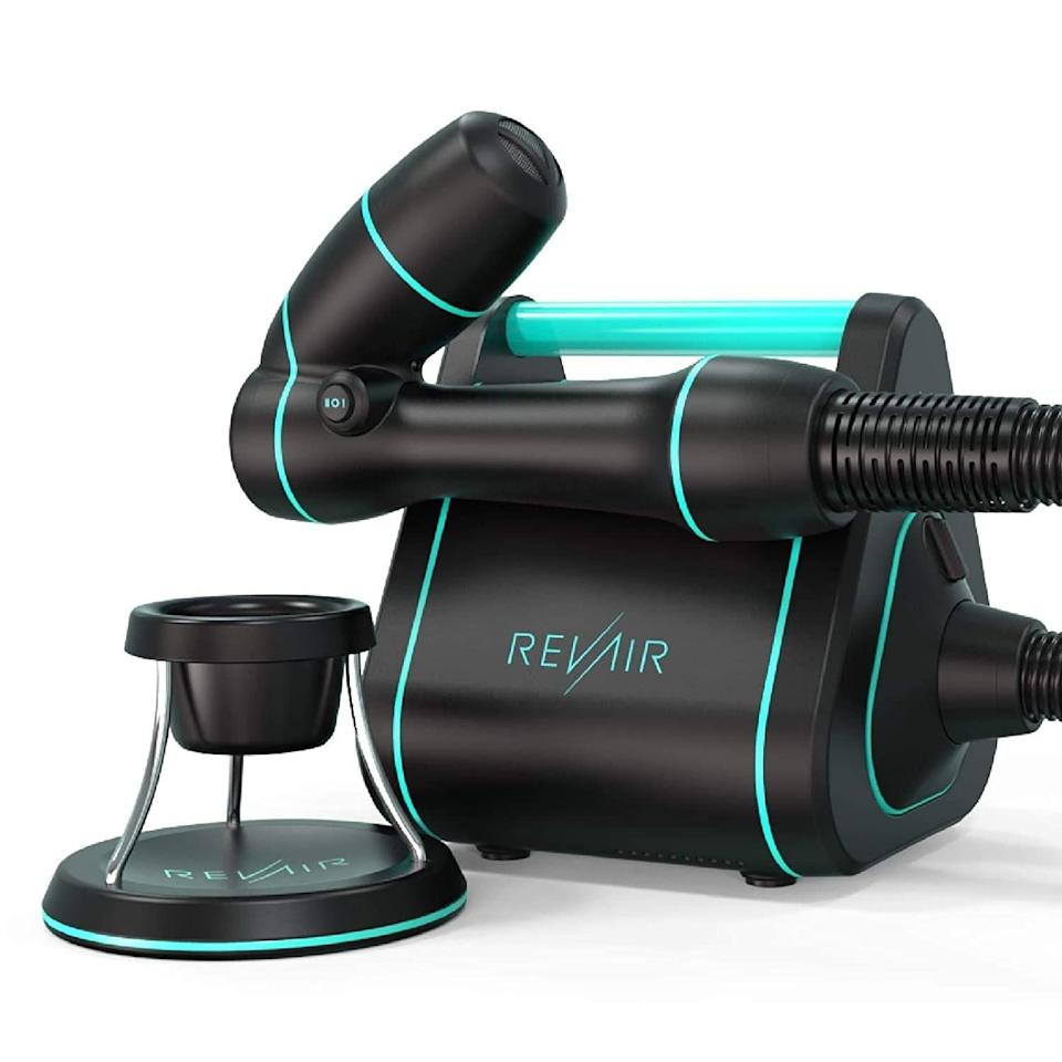 """At first glance, Revair's Reverse-Air Dryer looks more like a tiny home appliance than it does a hair styling tool. And honestly, the way the device works isn't far off from the mechanics of a vacuum cleaner. Once cranked up, the hair-dryer pulls sections of hair into the wand and smooths it out. The device's airflow goes in the same direction as your hair cuticles to slick them down rather than lifting in a way that makes hair look <a href=""""https://www.allure.com/gallery/the-best-frizz-fighting-hair-products?mbid=synd_yahoo_rss"""" rel=""""nofollow noopener"""" target=""""_blank"""" data-ylk=""""slk:frizzy"""" class=""""link rapid-noclick-resp"""">frizzy</a>."""