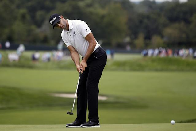 Cameron Tringale putts on the 14th hole during the second round of play at The Barclays golf tournament Friday, Aug. 22, 2014, in Paramus, N.J. (AP Photo/Mel Evans)
