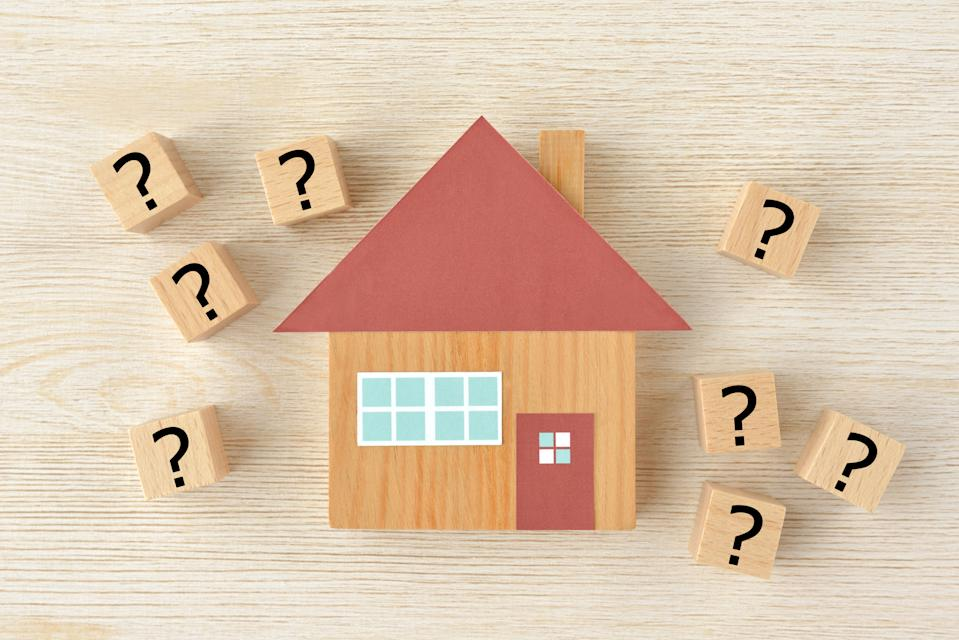 House object and wooden blocks with question mark