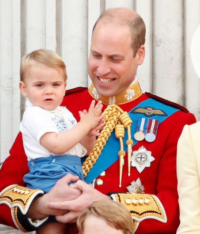 <p>Prince Louis makes his dad, Prince William, smile at his debut on the Buckingham Palace balcony for the annual Trooping the Colour ceremony. </p>