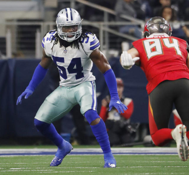 FILE - In this Sunday, Dec. 23, 2018 file photo, Dallas Cowboys linebacker Jaylon Smith against the Tampa Bay Buccaneers during an NFL game in Arlington, Texas. The Dallas Cowboys have given young linebacker Jaylon Smith a new contract while the holdout by Pro Bowl running back Ezekiel Elliott nears a month since the team reported to training camp. Smiths extension was announced Tuesday, Aug. 20, 2019. (AP Photo/Andy Jacobsohn, File)