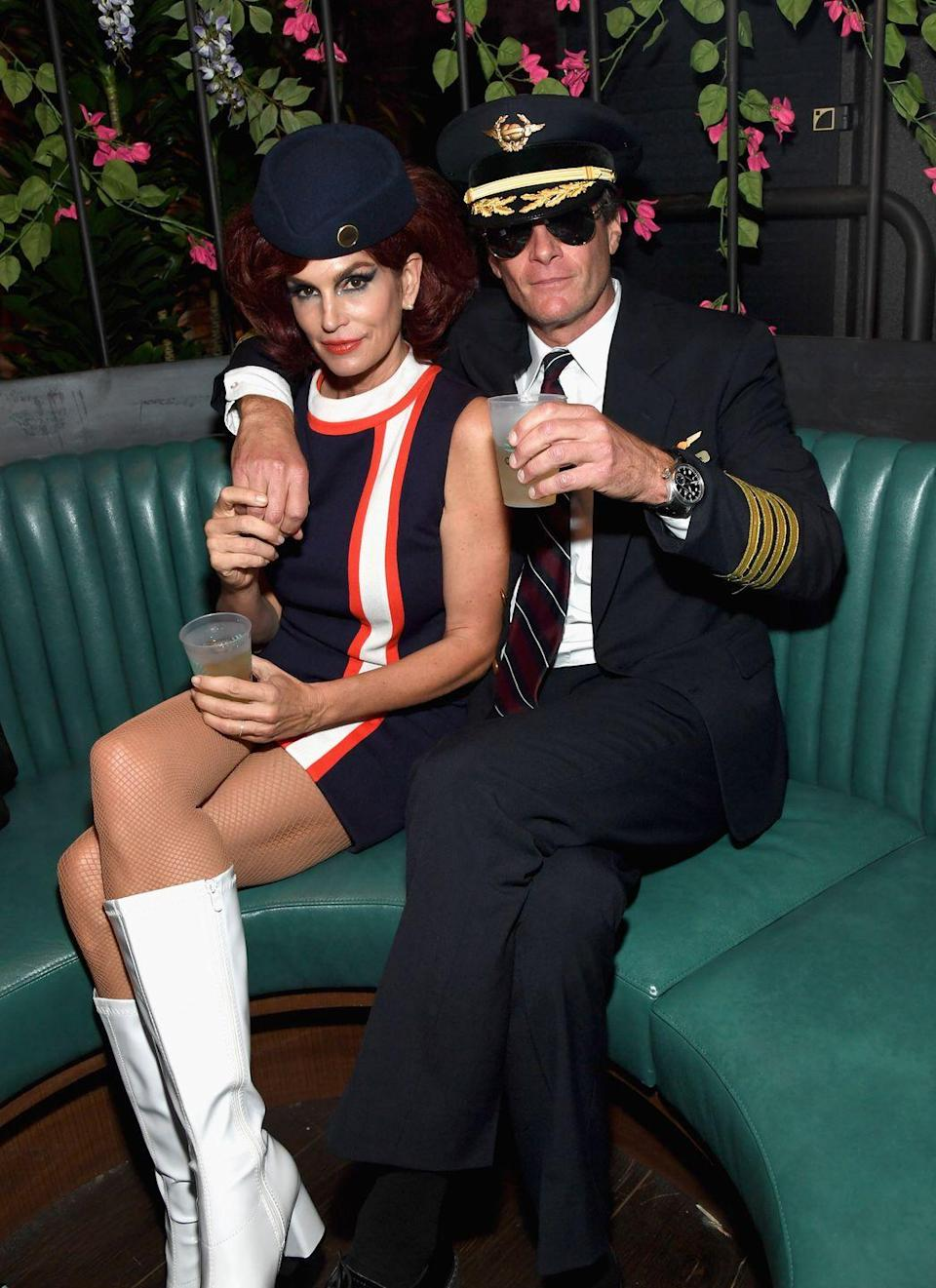 <p>Cozied up at one of <em>two</em> Casamigos Halloween parties in 2018, Cindy Crawford made an old-school flight attendant's uniform look überstylish, while her hubs Rande Gerber (a Casamigos cofounder) rocked a pilot outfit. (P.S. George Clooney joined in as a pilot, too.)</p>