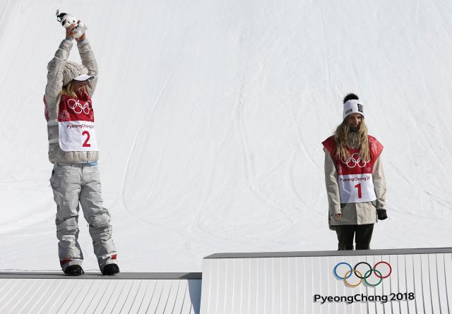 Snowboarding - Pyeongchang 2018 Winter Olympics - Women's Big Air Final Run 3 - Alpensia Ski Jumping Centre - Pyeongchang, South Korea - February 22, 2018 - Gold medallist Anna Gasser of Austria and silver medallist Jamie Anderson of the U.S. during the flower ceremony. REUTERS/Murad Sezer