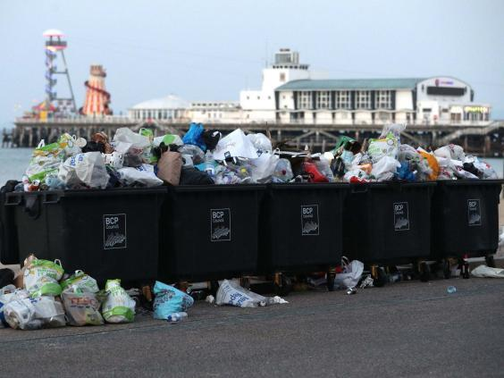 Waste ready to be collected on Bournemouth beach (PA)