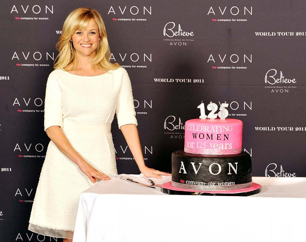 "Sporting a chic Giambattista Valli frock, Avon's Global Ambassador Reese Witherspoon celebrated the company's 125th Anniversary with a giant cake on a stop during the company's ""Global Believe Tour"" in Atlanta, Georgia, on Tuesday. Yum! Kevin Mazur/<a href=""http://www.wireimage.com"" target=""new"">WireImage.com</a> - January 25, 2011"