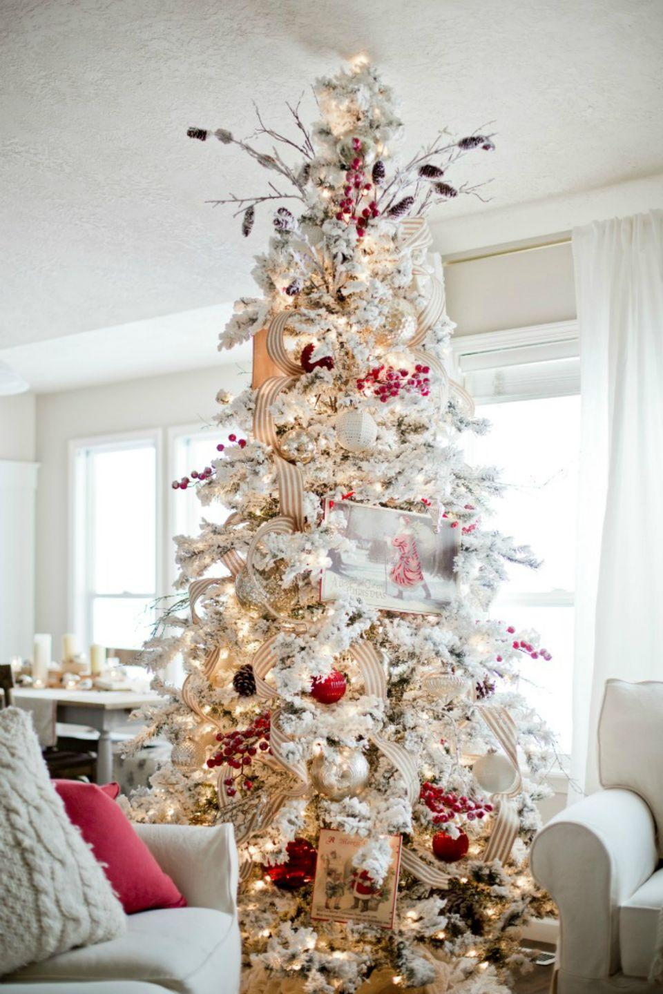 """<p>To achieve this magical snow-dusted effect, sprinkle your tree with snow flock. Add some soft holiday touches with frosted berry picks, red and white glass ornaments and burlap ribbon.</p><p><em><strong>Get the tutorial at </strong><strong><a href=""""http://www.ellaclaireinspired.com/how-to-decorate-a-christmas-tree/"""" rel=""""nofollow noopener"""" target=""""_blank"""" data-ylk=""""slk:Ella Claire & Co."""" class=""""link rapid-noclick-resp"""">Ella Claire & Co.</a></strong></em></p><p><span class=""""redactor-invisible-space""""><a class=""""link rapid-noclick-resp"""" href=""""https://www.amazon.com/SnoWonder-Instant-Snow-Artificial-Gallons/dp/B00KVO8CSC?tag=syn-yahoo-20&ascsubtag=%5Bartid%7C10070.g.2025%5Bsrc%7Cyahoo-us"""" rel=""""nofollow noopener"""" target=""""_blank"""" data-ylk=""""slk:BUY ARTIFICIAL SNOW"""">BUY ARTIFICIAL SNOW</a></span><br></p><p><strong>_______________________________________________________</strong><strong>__</strong></p><p><em>Want to make your holidays shine? You're in luck! <a href=""""https://subscribe.hearstmags.com/subscribe/womansday/253396?source=wdy_edit_article"""" rel=""""nofollow noopener"""" target=""""_blank"""" data-ylk=""""slk:Subscribe to Woman's Day"""" class=""""link rapid-noclick-resp"""">Subscribe to Woman's Day</a> today and get <strong>73% off your first 12 issues</strong>. And while you're at it, <a href=""""https://subscribe.hearstmags.com/circulation/shared/email/newsletters/signup/wdy-su01.html"""" rel=""""nofollow noopener"""" target=""""_blank"""" data-ylk=""""slk:sign up for our FREE newsletter"""" class=""""link rapid-noclick-resp"""">sign up for our FREE newsletter</a> for even more of the Woman's Day content you want.</em></p>"""