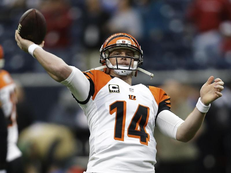 Cincinnati Bengals quarterback Andy Dalton warms up before an NFL wild card playoff football game against the Houston Texans Saturday, Jan. 5, 2013, in Houston. (AP Photo/Eric Gay)