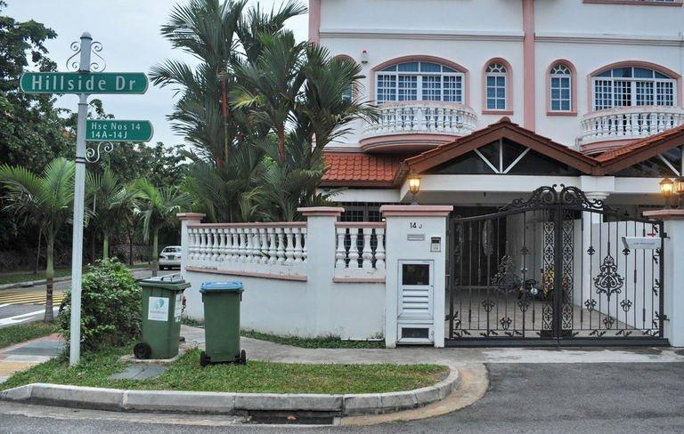 The house on July 14, 2013 where Singapore policeman Iskandar Rahmat allegedly killed car workshop owner Tan Boon Sin. The man was fatally slashed in his home while his son's body was found a kilometre away