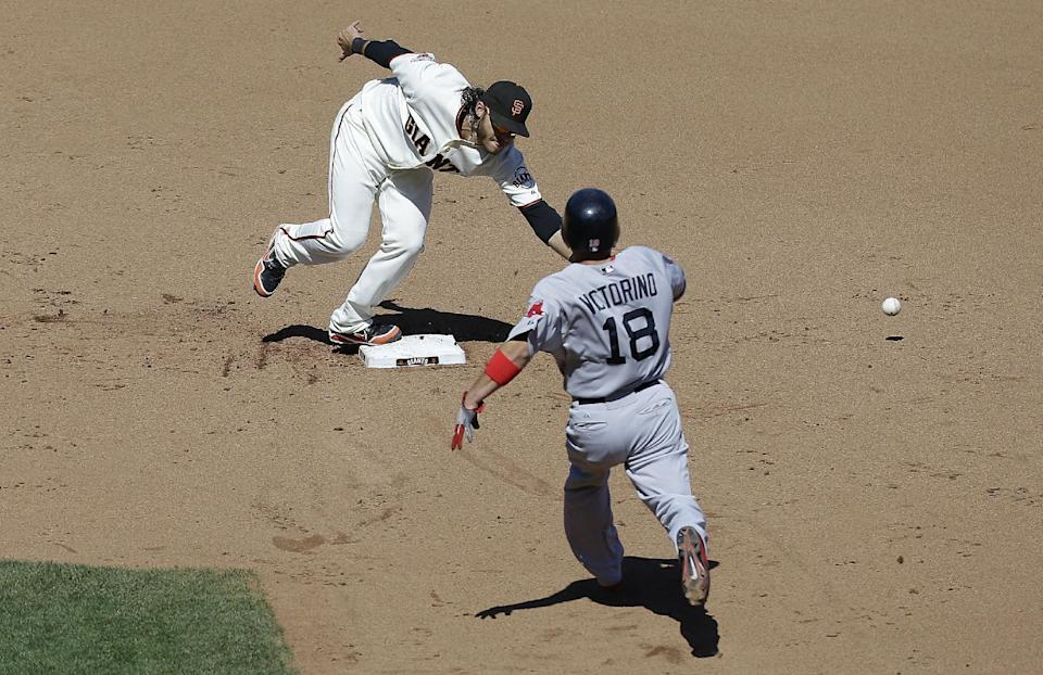 San Francisco Giants shortstop Brandon Crawford, top, cannot catch the ball after a throwing error by San Francisco Giants pitcher Michael Kickham as Boston Red Sox's Shane Victorino (18) runs toward second base during the eighth inning of a baseball game in San Francisco, Wednesday, Aug. 21, 2013. (AP Photo/Jeff Chiu)