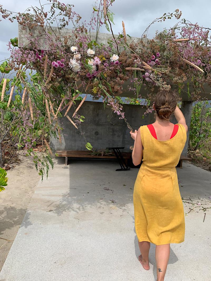 Taylor of Fox Fodder Farm, a friend who came to our wedding and also created our flower arrangements. Here she is creating the flower sculpture above the spot where we had our ceremony.