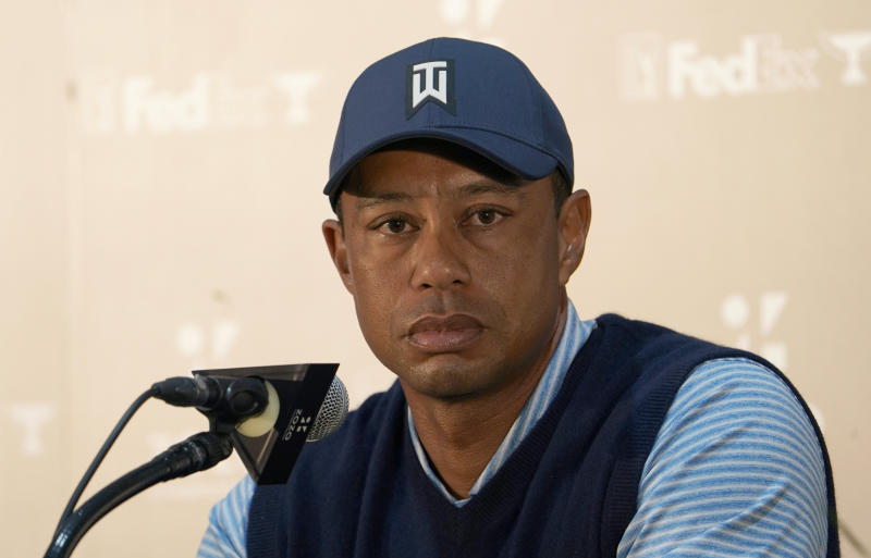 Tiger Woods of the United States listens to reporter's question during a news conference ahead of the Challenge: Japan Skins event at Accordia Golf Narashino C.C. in Inzai, Japan, Monday, Oct. 21, 2019. Tiger Woods will play at the Zozo Championship PGA Tour which will be held at Oct. 24-27. (AP Photo/Lee Jin-man)