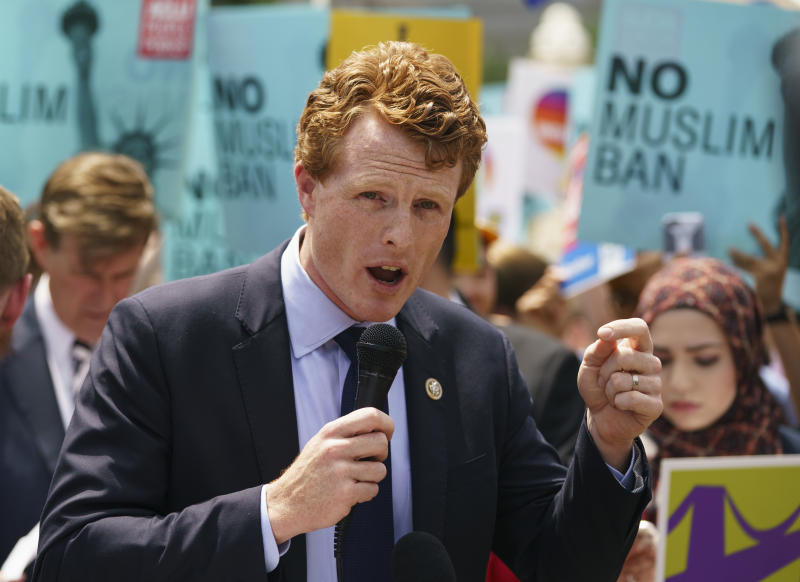 "FILE - In this June 26, 2018 file photo, Rep. Joe Kennedy, D-Mass., speaks during the ""We Will Not Be Banned"" protest sponsored by Muslim Advocates in front of the Supreme Court in Washington.  Some Massachusetts voters see Sen. Edward Markey as potentially vulnerable to a primary challenge, and one group is even trying to persuade Kennedy to run for his seat. Markey already has two declared primary challengers, and now a group has launched a bid to draft Kennedy. The congressman has said he doesn't want the seat. (AP Photo/Carolyn Kaster, File)"