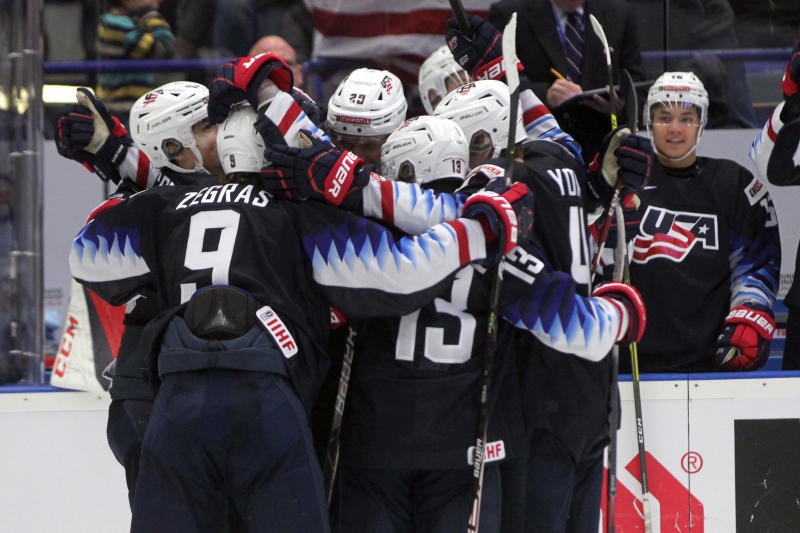 USA players celebrate their first goal during the 2020 IIHF World Junior Ice Hockey Championships Group B match between USA and Russia in Ostrava, Czech Republic, Sunday, Dec. 29, 2019. (Petr Sznapka/CTK via AP)