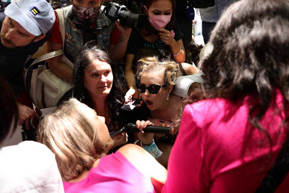 LOS ANGELES, CALIFORNIA - JUNE 23: #FreeBritney activists react to comments made by Britney Spears while listening to a feed from the courtroom during a protest at Los Angeles Grand Park during a conservatorship hearing for Spears on June 23, 2021 in Los Angeles, California. Spears is addressing the court remotely.  Spears was placed in a conservatorship managed by her father, Jamie Spears, and an attorney, which controls her assets and business dealings, following her involuntary hospitalization for mental care in 2008. (Photo by Rich Fury/Getty Images)