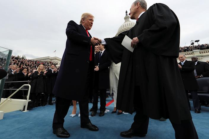 Someday the bout couldbe President Donald Trump vs. Chief Justice John Roberts. (Photo: Jim Bourg / Reuters)