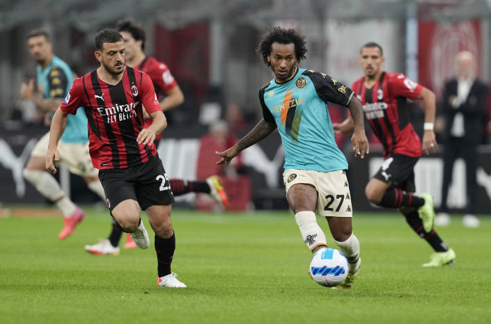Venezia's Gianluca Busio, right, challenges for the ball with AC Milan's Alessandro Florenzi during the Serie A soccer match between AC Milan and Venezia at the San Siro stadium, in Milan, Italy, Wednesday, Sept. 22, 2021. Italian soccer team Venezia is back in the top division for the first time since 2002. And it has tapped Major League Soccer to recruit young Americans in its bid to stay afloat in Serie A. Nineteen-year-old Gianluca Busio arrived in Venice from Sporting Kansas City and 20-year-old Tanner Tessmann from FC Dallas. (AP Photo/Antonio Calanni)