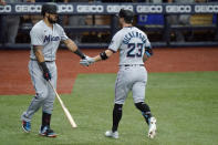 Miami Marlins' Corey Dickerson (23) celebrates his solo home run off Tampa Bay Rays' Josh Fleming with on-deck batter Jorge Alfaro during the third inning of a baseball game Friday, Sept. 4, 2020, in St. Petersburg, Fla. (AP Photo/Chris O'Meara)