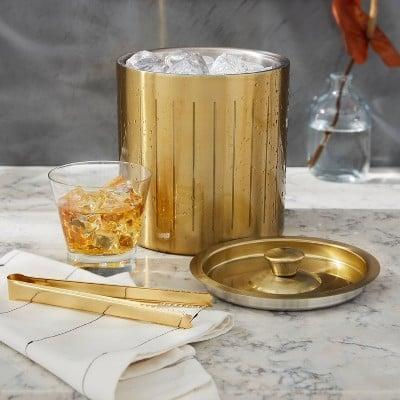 <p>The <span>Project 62 3L Stainless Steel Ice Bucket with Tongs Gold</span> ($20) will look stunning on any bar cart.</p>
