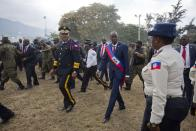 FILE - In this Feb. 7, 2017 file photo, newly sworn-in Haitian President Jovenel Moise walks with Police Chief Michel-Ange Gedeon past National Police at the National Palace after his inauguration ceremony at Parliament in Port-au-Prince, Haiti. Moïse was assassinated in an attack on his private residence early Wednesday, July 7, 2021, according to a statement from the country's interim prime minister. (AP Photo/Dieu Nalio Chery, File)