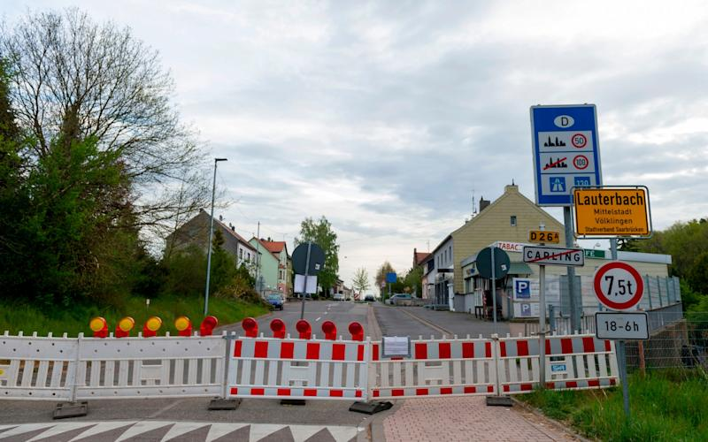 FILES) This file photo taken on April 18, 2020 shows the closed German-French border between Carling in France and Lauterbach in Germany, on the 33rd day of a lockdown in France aimed at curbing the spread of the COVID-19 infection caused by the novel coronavirus. - An European coordination for a return to free movement between European countries is delicate, between health imperatives and economic emergency, after the closings of the borders which have damaged a symbol of the European Union. (Photo by JEAN-CHRISTOPHE VERHAEGEN / AFP) (Photo by JEAN-CHRISTOPHE VERHAEGEN/AFP via Getty Images) - JEAN-CHRISTOPHE VERHAEGEN/AFP