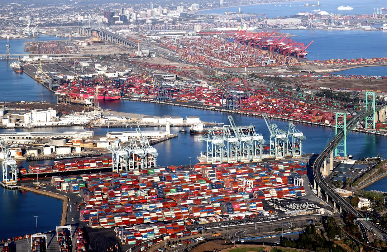 In an aerial view, shipping containers and container ships are seen at the ports of Long Beach and Los Angeles on September 20, 2021 near Los Angeles, California. (Mario Tama/Getty Images)