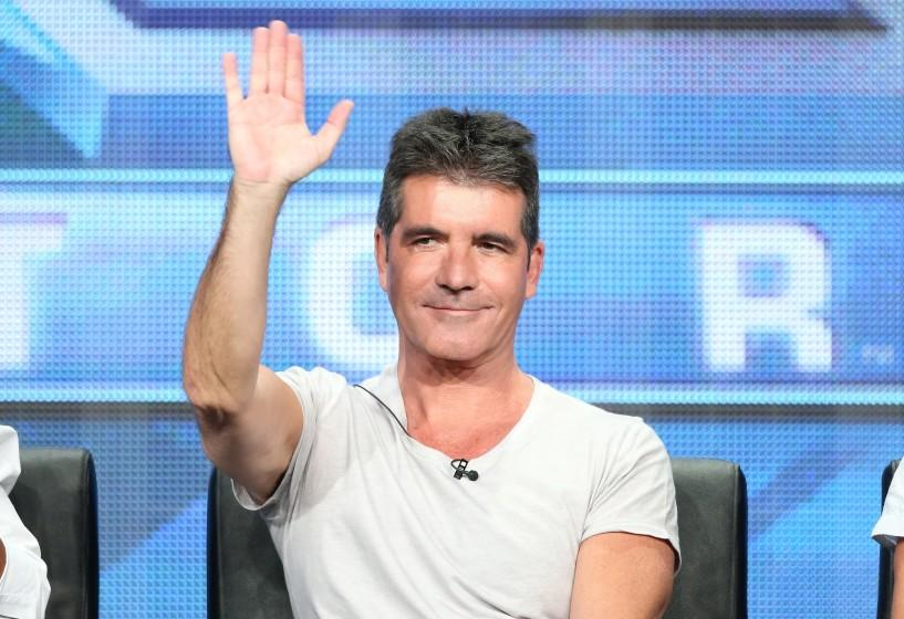 """Simon Cowell speaks during the """"The X Factor"""" panel discussion at the 2013 Summer Television Critics Assn. tour in Beverly Hills."""
