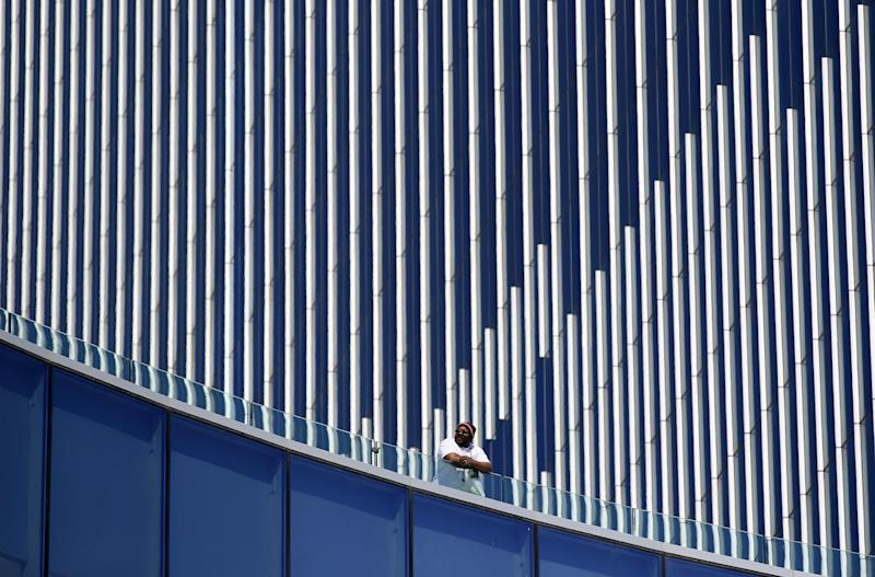A worker looks from the side of Revel in Atlantic City, N.J., Monday, March 19, 2012. Revel, the casino-resort opening April 2, breaks all the old casino rules. The smoke-free resort embraces the ocean rather than turning its back on it. (AP Photo/Mel Evans)