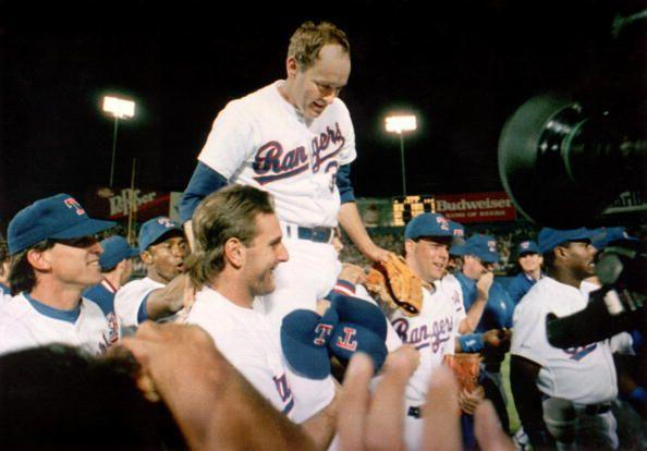 """<p><strong>May 1, 1991</strong>: At Arlington Stadium, the legendary but badly banged-up Nolan Ryan, age 44, takes the mound for the Texas Rangers against Toronto. After holding the Blue Jays hitless for the first eight and two-thirds innings, Ryan has only Roberto Alamar standing in the way of an unprecedented seventh no-no. With the count at 2-2, Ryan's final pitch starts to the plate and explodes at 93 miles per hour as Alomar swings and misses. Bedlam is on parade at Arlington. Ryan's teammates surge out on the field, lifting him onto their shoulders. """"My teammates were excited for me and involved in it,"""" the righty told Harvey Frommer, author of Ryan's biography <em><a href=""""https://www.amazon.com/Throwing-Heat-Autobiography-Nolan-Ryan/dp/038524438X?tag=syn-yahoo-20&ascsubtag=%5Bartid%7C10054.g.28170941%5Bsrc%7Cyahoo-us"""" rel=""""nofollow noopener"""" target=""""_blank"""" data-ylk=""""slk:Throwing Heat"""" class=""""link rapid-noclick-resp"""">Throwing Heat</a></em>, """"and the fans rallied.""""<br> </p>"""