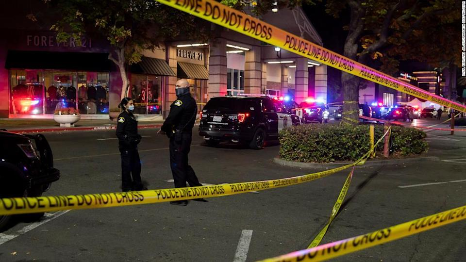 """<p>Sacramento police officers stand outside the mall Friday evening following the shooting, which left two people dead. </p><div class=""""cnn--image__credit""""><em><small>Credit: Paul Kitagaki Jr./Sacramento Bee/TNS/Sipa / Sipa</small></em></div>"""