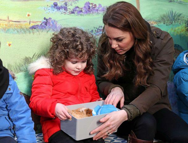 PHOTO: Britain's Catherine, Duchess of Cambridge, looks at a Guinea pig (Pool/Reuters)