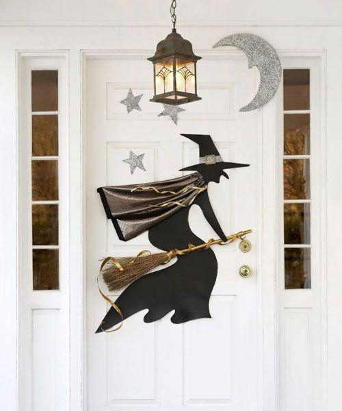 "<p>Your entryway light will make this Halloween door decoration sparkle and shine thanks to the glittery materials used throughout.</p><p><strong>Get the tutorial at <a href=""https://www.goodhousekeeping.com/holidays/halloween-ideas/a19159/printable-halloween-witch-template/"" rel=""nofollow noopener"" target=""_blank"" data-ylk=""slk:Good Housekeeping"" class=""link rapid-noclick-resp"">Good Housekeeping</a>.</strong></p><p><a class=""link rapid-noclick-resp"" href=""https://www.amazon.com/Matte-Black-Removable-Repositionable-Adhesive/dp/B074MYNK14/?tag=syn-yahoo-20&ascsubtag=%5Bartid%7C10050.g.22350299%5Bsrc%7Cyahoo-us"" rel=""nofollow noopener"" target=""_blank"" data-ylk=""slk:SHOP BLACK VINYL"">SHOP BLACK VINYL</a><br></p>"