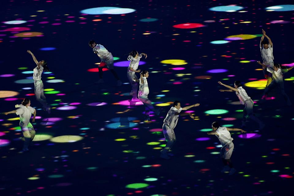 Performers dance during the opening ceremony of the Olympic Games.