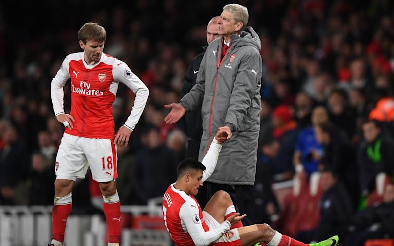 Alexis Sanchez reacts to having the ball thrown at him - Getty Images Europe