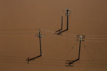 An aerial view showing electricity poles half-submerged in flood in Khuzestan province, Iran, April 5, 2019. Picture taken April 5, 2019. Mehdi Pedramkhoo/Tasnim News Agency/via REUTERS