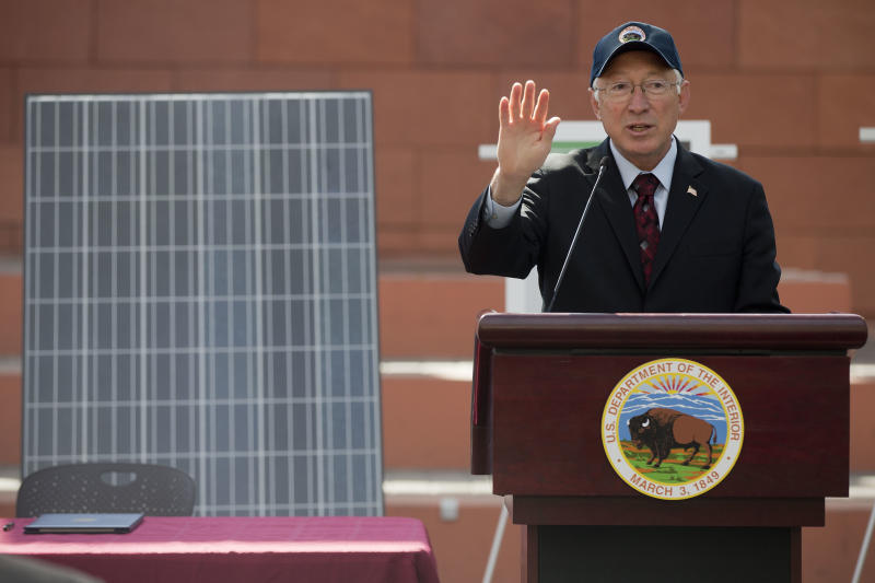 "Interior Secretary Ken Salazar speaks during a news conference, Friday, Oct. 12, 2012, in Las Vegas, in which he and Senate Majority Leader Harry Reid announced a plan that sets aside 285,000 acres of public land for the development of large-scale solar power plants. The government is establishing 17 new ""solar energy zones"" on 285,000 acres in six states: California, Nevada, Arizona, Utah, Colorado and New Mexico. Most of the land,153,627 acres, is in Southern California. (AP Photo/Julie Jacobson)."
